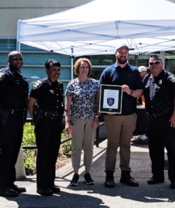 Seattle Mayor Durkan, SPD Chief Best and others with Marcus Johnson award July 2019