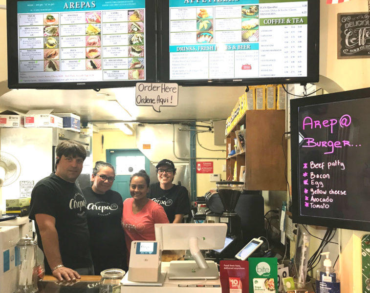 Four members of the staff of Arepa Venezuelan Kitchen