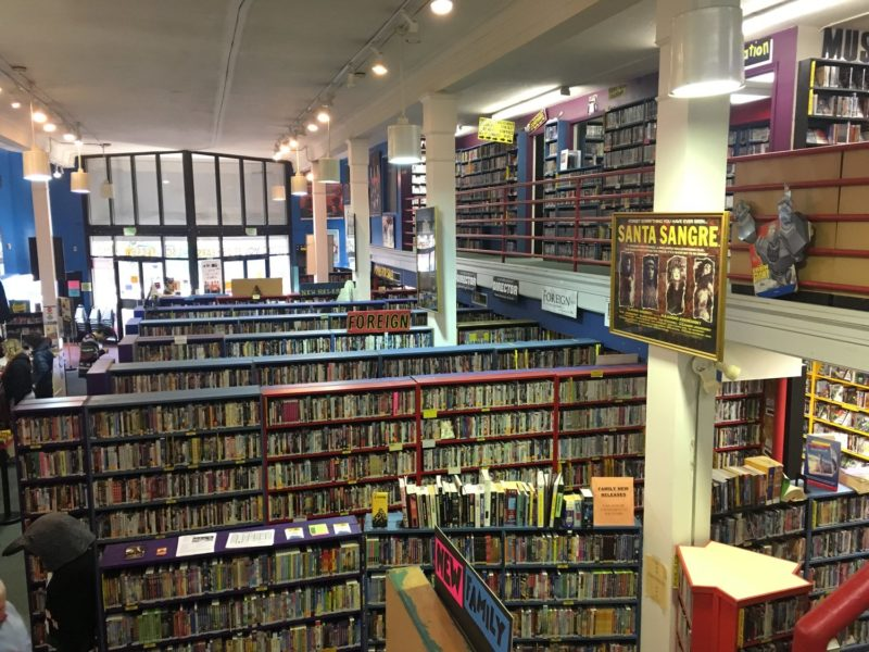 Interior of Scarecrow Video shows rows of shelves stocked with DVDs