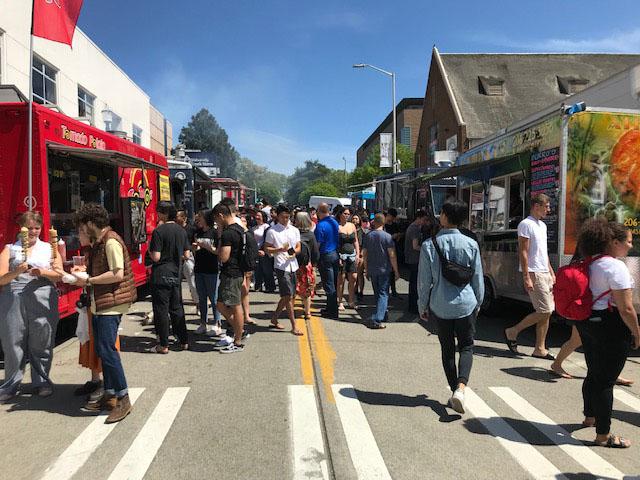 People lining up at food trucks
